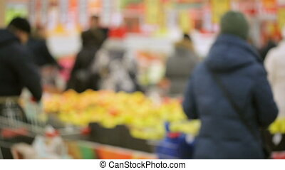 Customers in supermarket out of focus