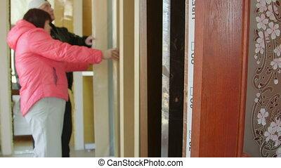 Customers looking for new interior door in the doors store showroom