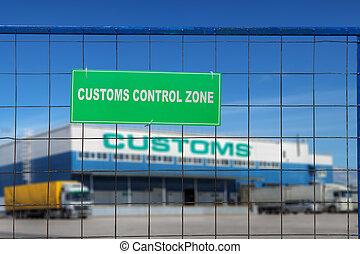 Customs control area with lorries near warehouse logistics center.