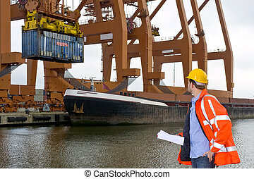 Customs Control at an industrial Harbor - A male customs...