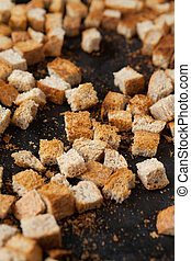 cut by cubes dried bread in the oven,