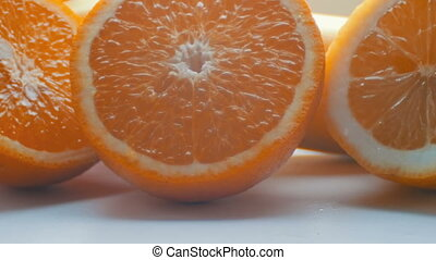 Cut citrus lemon and orange close-up view close on a white...