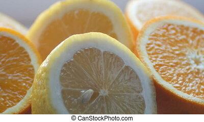 Cut citrus lemon and orange close-up view close on a white background