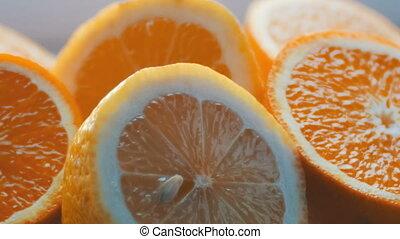 Cut citrus lemon and orange close-up view close on a white...