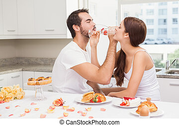 Cut couple drinking champagne together