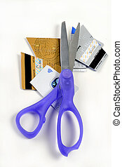 Cut credit cards with scissors. - Pile of cut up credit...