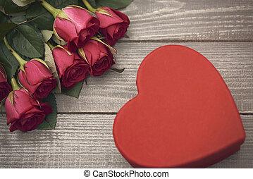 Cut flowers and heart shape box