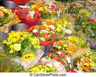 Display of cut flowers on a French market stall.