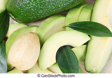 Cut fresh avocado with leaves