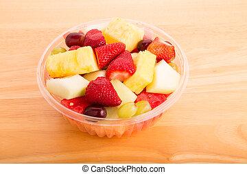 Cut Fresh Fruit in Plastic Bowl