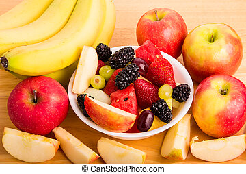 Cut Fruit in Bowl with Bananas and Whole and Cut Apples