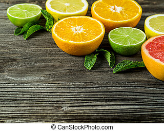 Cut fruit on rustic wood background