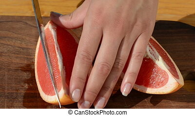 cut grapefruit pomelo - hand cut chop slice fresh ripe juicy...