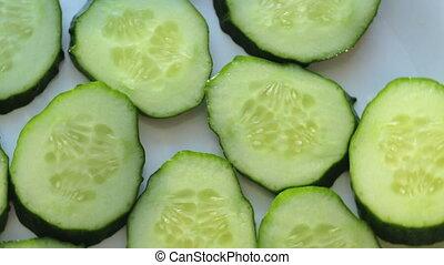 Cut green cucumber - Footage of cut green cucumber, rotating...
