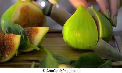 Cut green figs and basil leaves - Close-up shot of cutting...