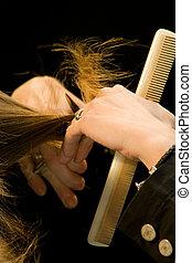 cut hair - hairdresser cutting blonde hair
