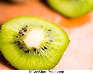Cut into pieces kiwi macro. Kiwi, cut into slices