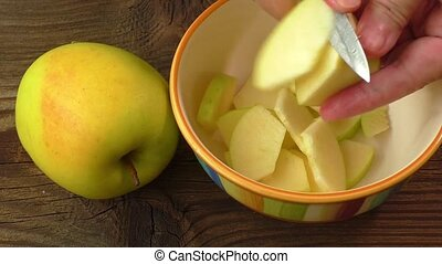 Cut into slices of apples in a bowl