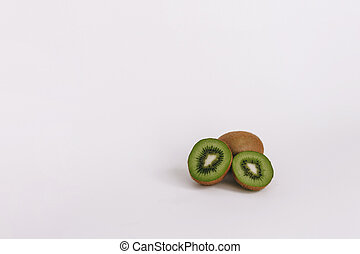 Cut kiwi on a white background with a place for text
