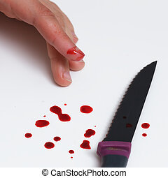 cut of finger while cooking. Blood drops on table
