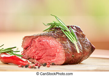 Cut off piece of cooked meat.