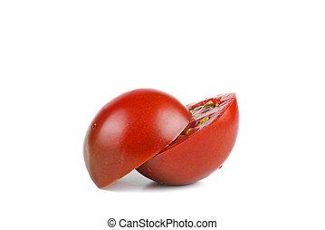 Cut on half tomato isolated on white background.