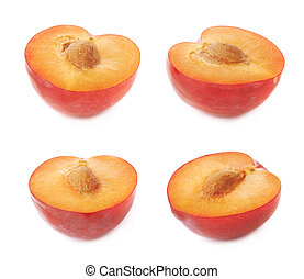 Cut open plum half isolated