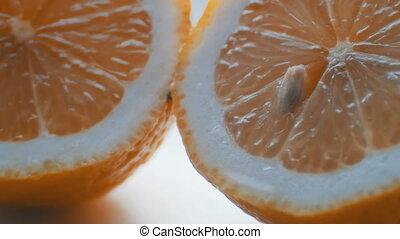 Cut orange macro close up view on white background - Cut...