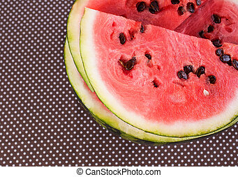 Cut pieces of red watermelon on a plate