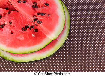 Cut pieces of red watermelon on a plate.