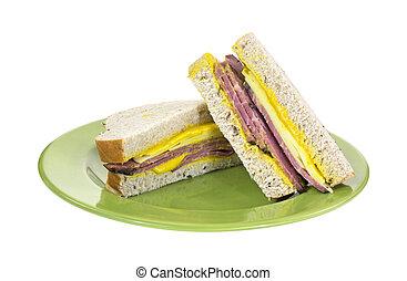 Cut prosciutto Swiss cheese sandwich