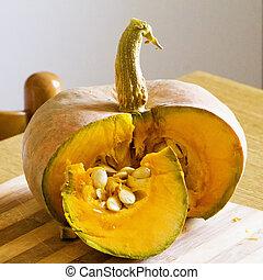 Cut pumpkin over chopping board