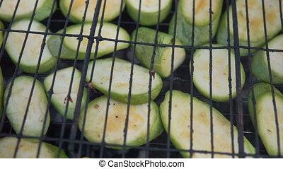 Cut pumpkins on grill, vegetarian food