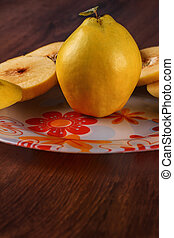 Cut quince on the plate