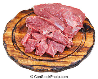 cut raw meat on cutting wooden board