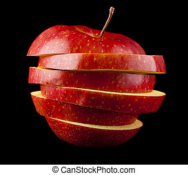 cut red apple on a black background