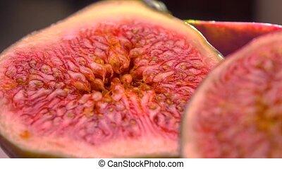 Cut ripe figs 4K macro pan shot - Cut figs 4K closeup pan...