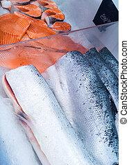 cut salmon in market refrigerator