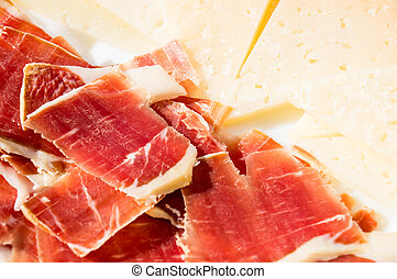 cut slices of ham (panish jamon iberico) and cheese