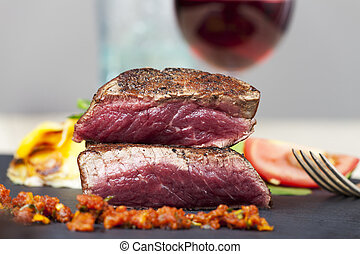 cut steak with red wine