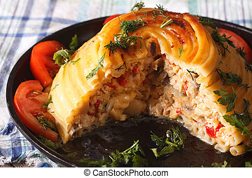 Cut timbale of pasta stuffed with chicken, mushrooms and ...