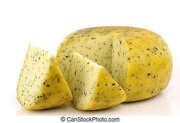 cut traditional Gouda herb cheese
