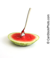 Cut watermelon with spoon isolated on white background.