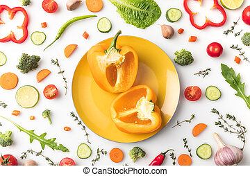 cut yellow bell pepper on plate