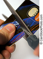 Cut your credit card - Macro image of scissors cutting...