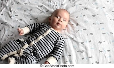 Cute 2 month old baby wake up - Cute 2 month old baby lying...