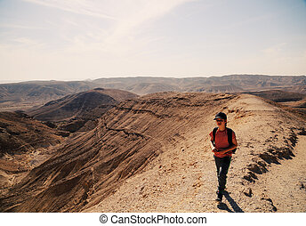 Cute 8 years old boy hiking in the desert - Cute 8 years old...