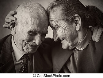 Cute 80 plus year old married couple posing for a portrait...