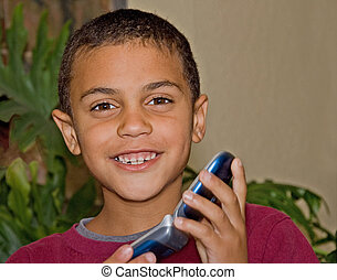 Cute 9 Year Old Bi-Racial Boy With Cell Phone - This cute 9...