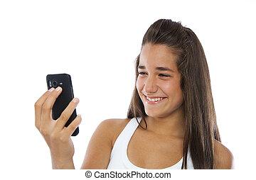cute, adolescente, sorrindo, com, um, telefone móvel